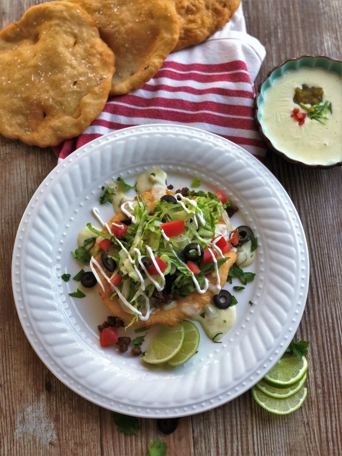 Fry bread tacos on white plate