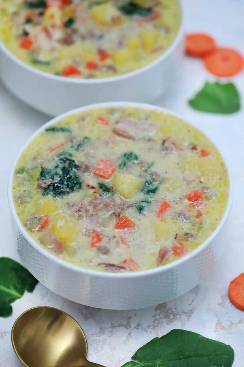 White bowl of zuppa toscana soup