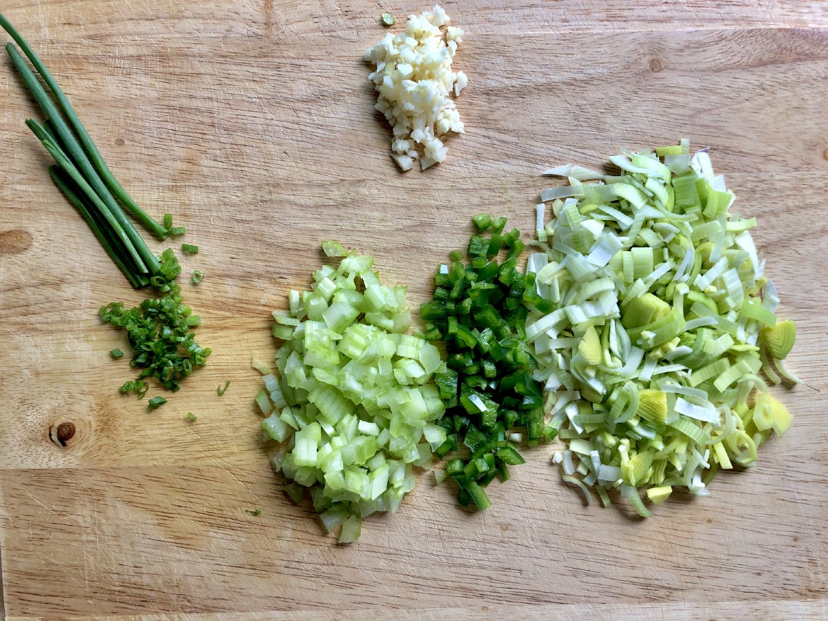 Minced herbs on cutting board