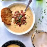White bowl of bacon cheddar beer cheese soup