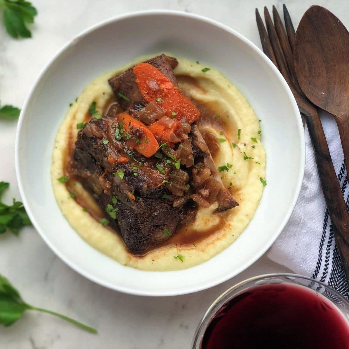 Braised short rib on puree in white bowl