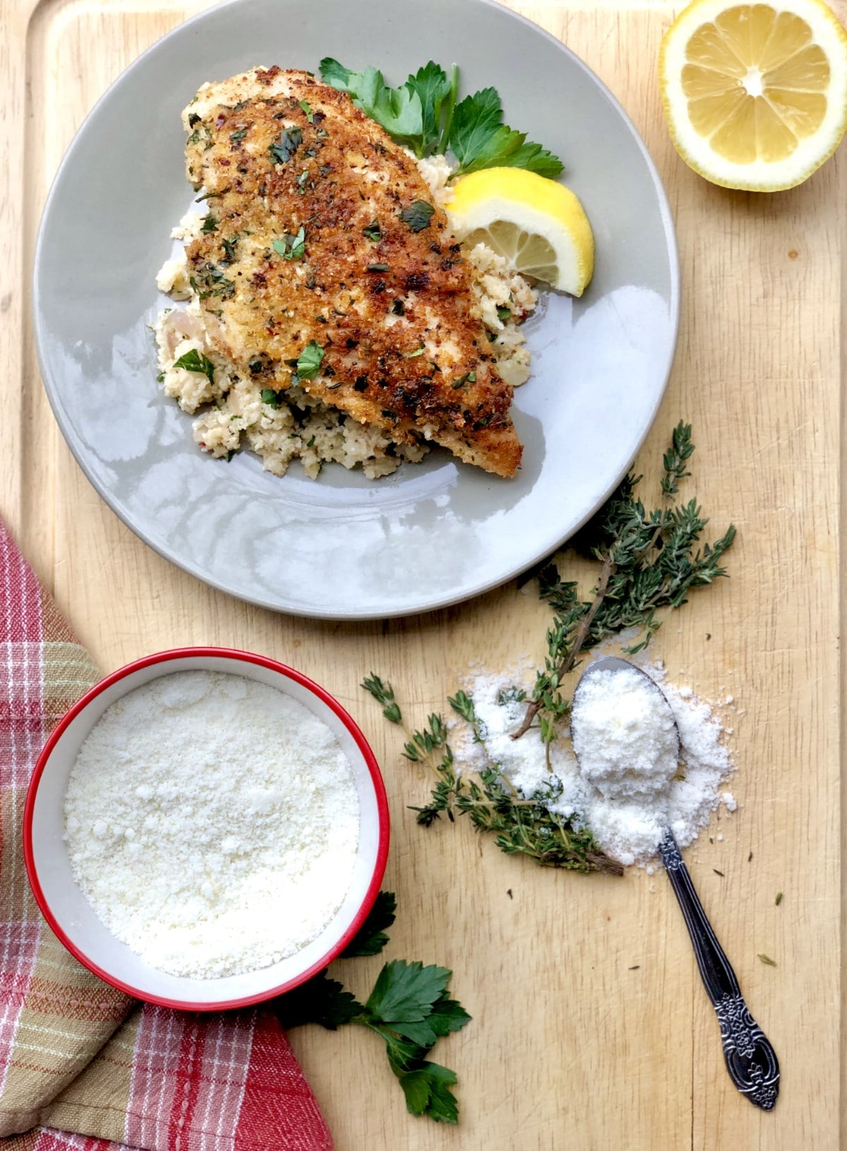 Garlic herb chicken on white plate