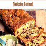 Loaf of cinnamon raisin bread on cutting board