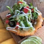 Fry bread taco with lettuce and tomato