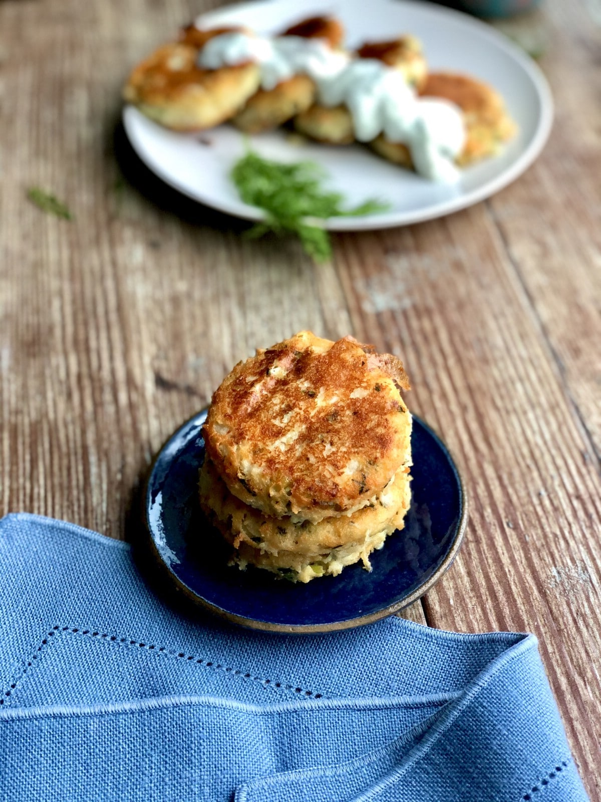 Stack of potato cakes on blue plate