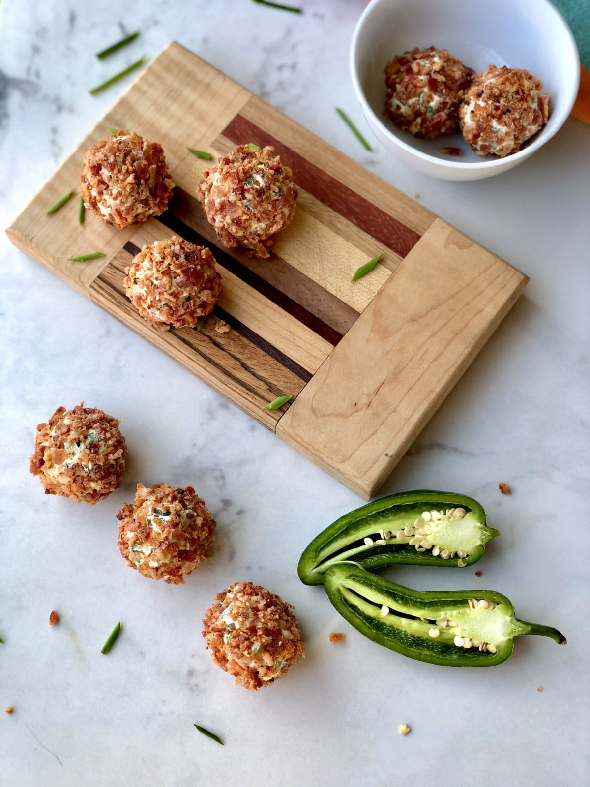 Jalapeno poppers on cutting board