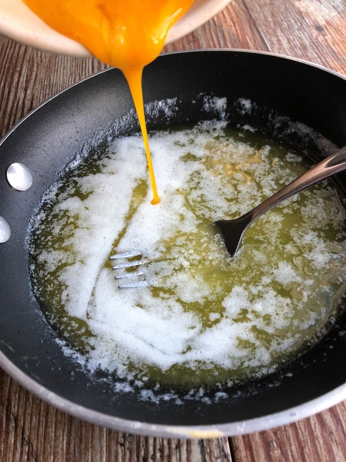Stirring ingredients in skillet