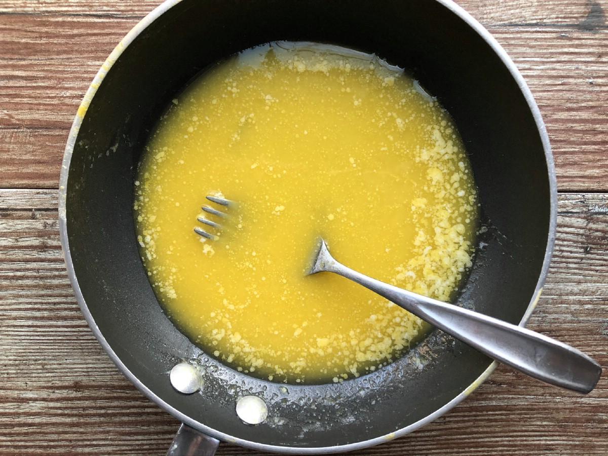 Stirring curd in skillet