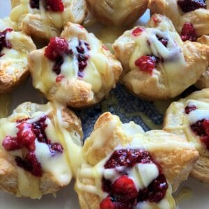 Raspberry tarts on white plate