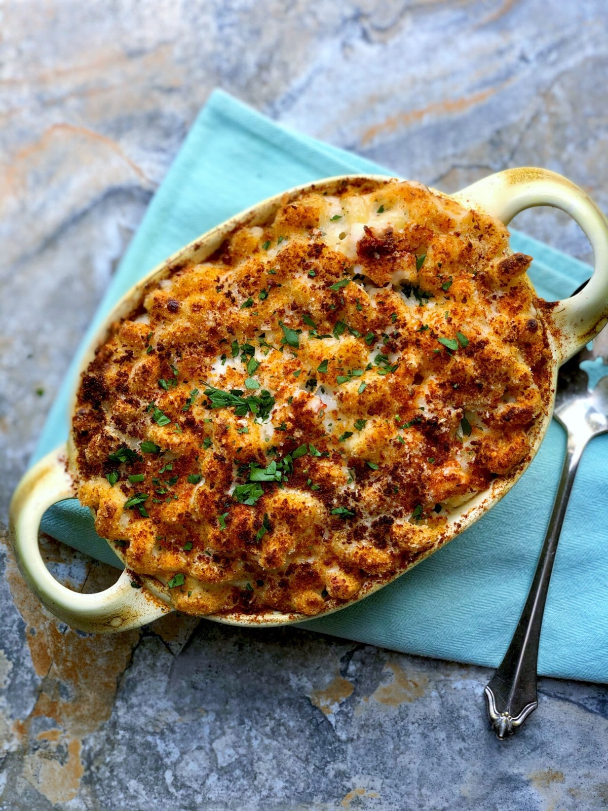 Baking dish filled with lobster mac and cheese