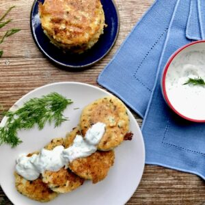 Potato cakes on plate with dill sauce