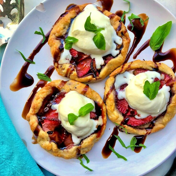 Strawberry balsamic galettes on white plate