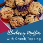 Stack of blueberry muffins with crum top