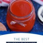 Jar of buffalo sauce on blue napkin