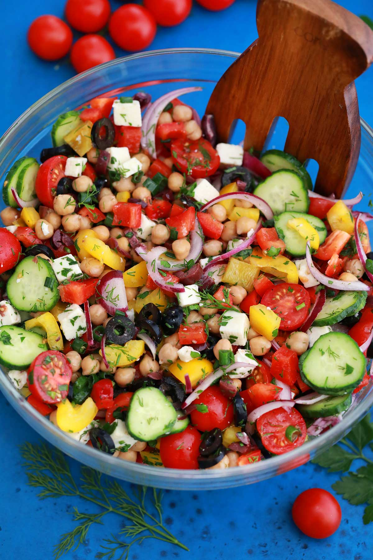 Mixing salad in bowl