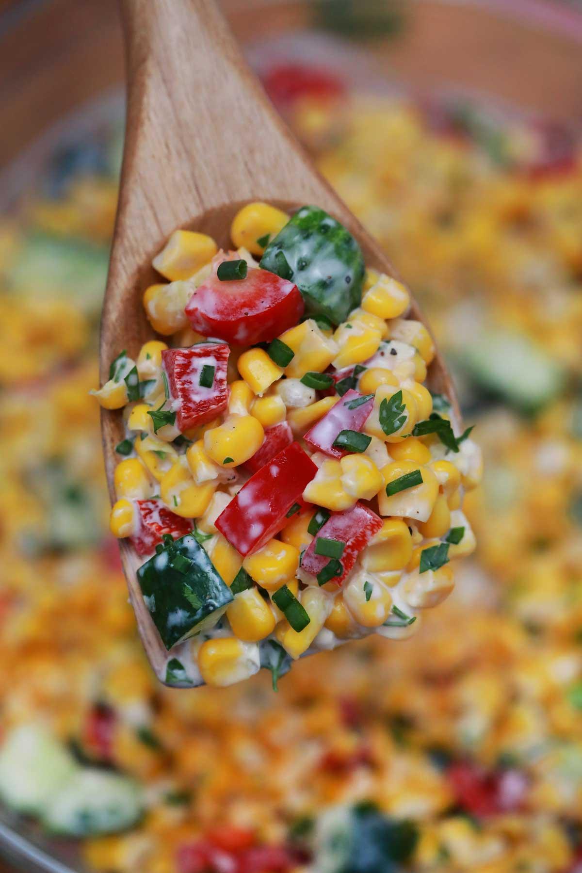 Wooden spoon of corn salad
