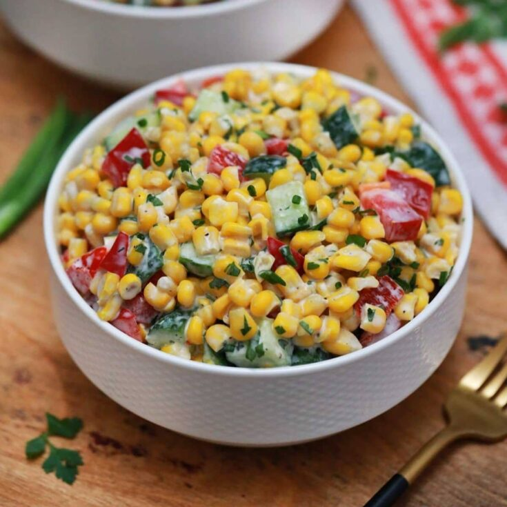 Corn salad in white bowl