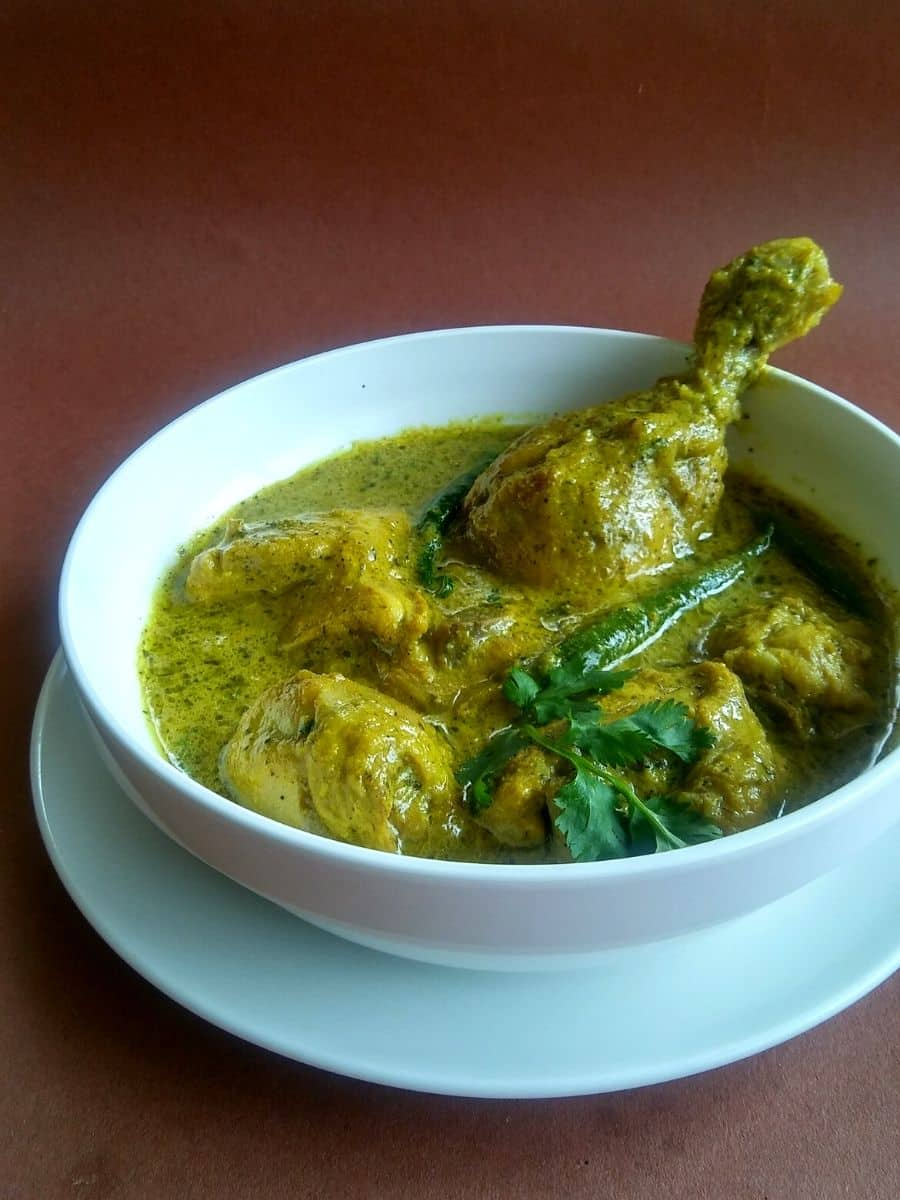 Green curry chicken in white bowl