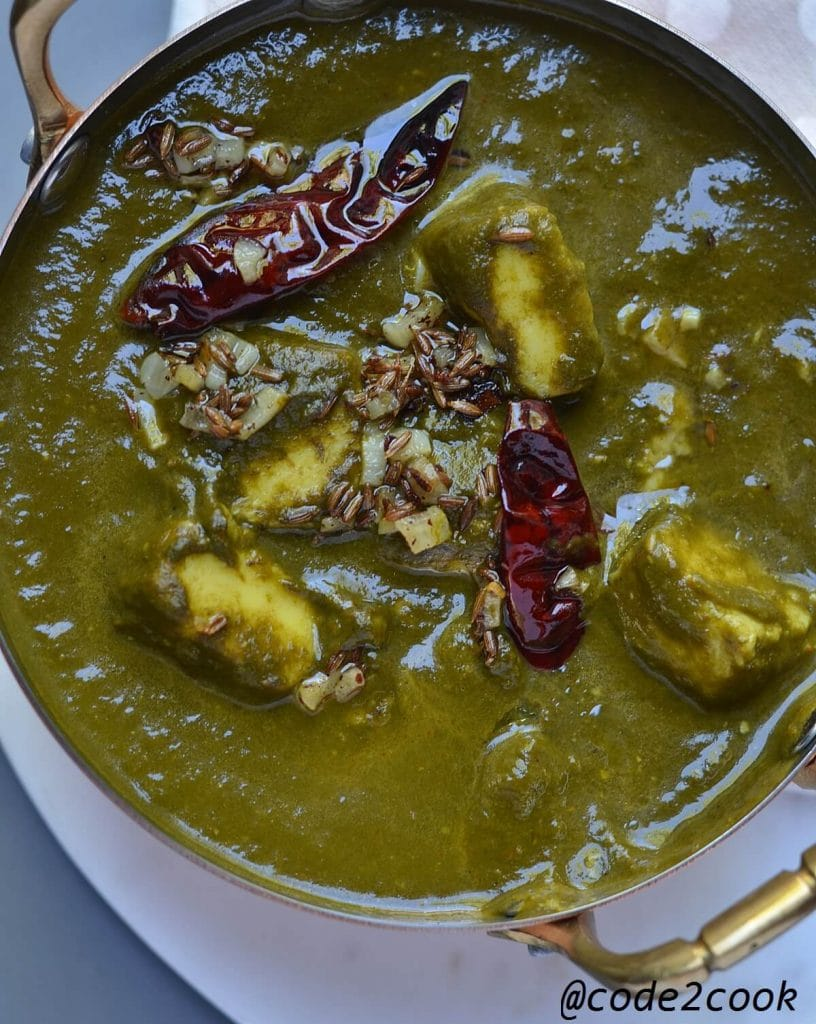 Palak paneer in bowl with chiles