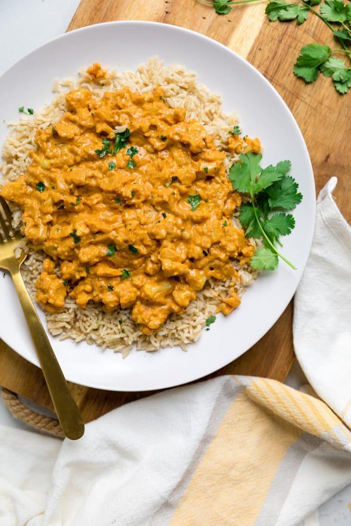 Cauliflower curry on white plate