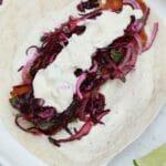 Single taco on white plate