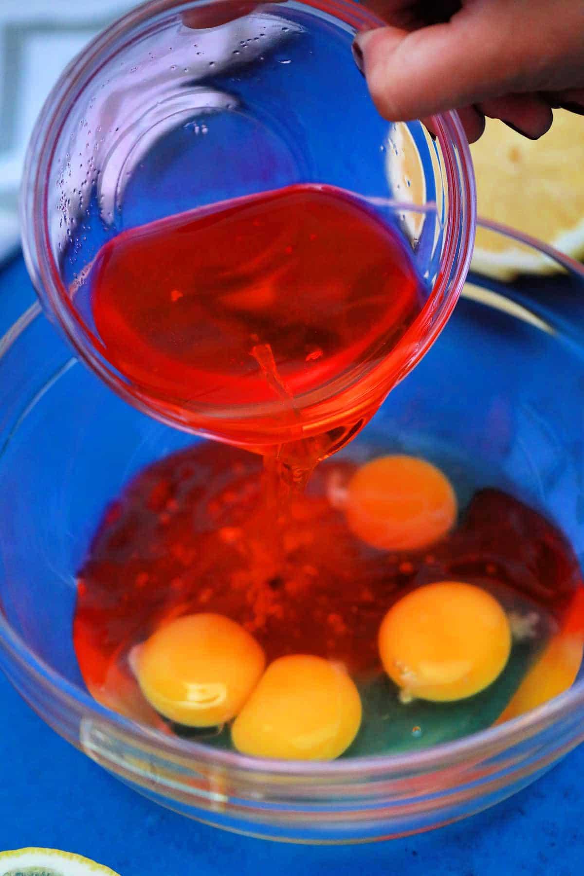 Adding pinkl emonade to eggs