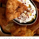 Pita chip laying on yogurt dip