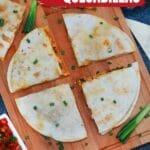 Sliced quesadilla on cutting board