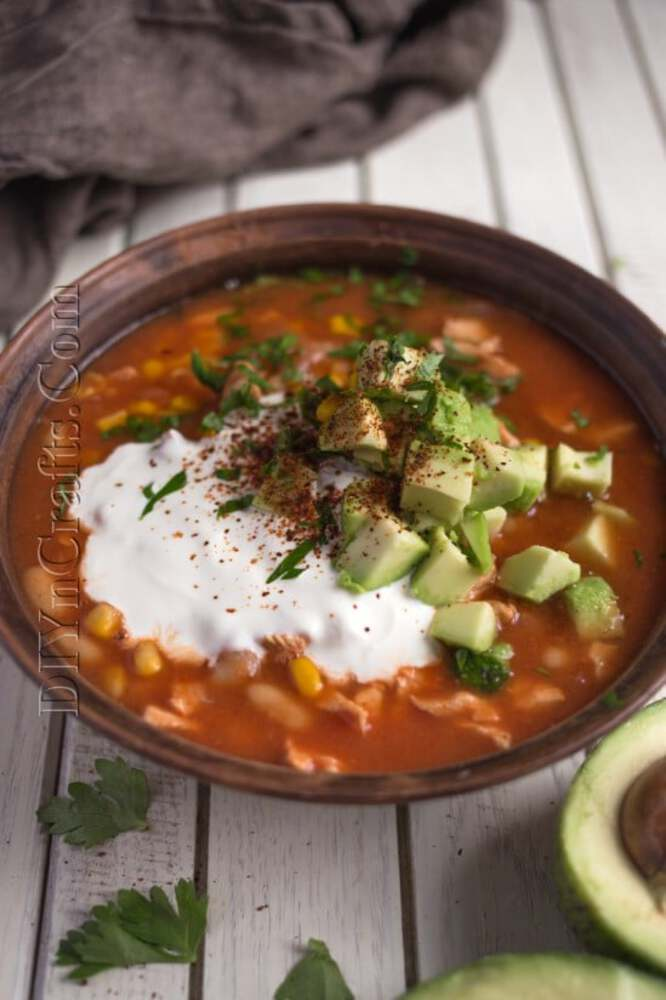 Taco soup with sour cream on top