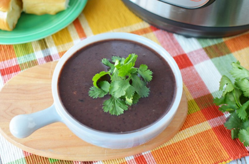 Black bean soup in bowl on plaid napkin