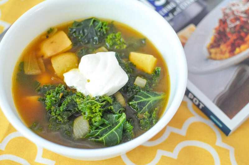 Soup in white bowl on yellow napkin