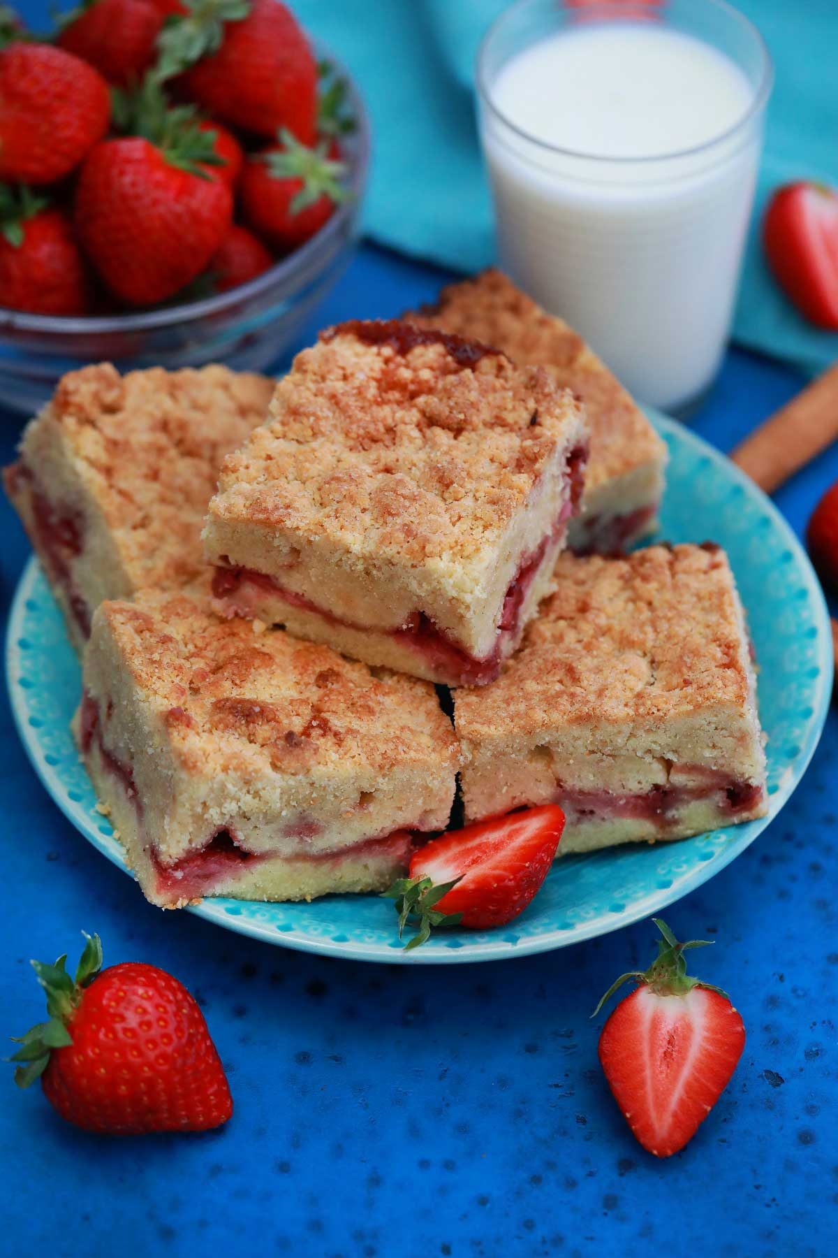 Strawberry bars on teal plate