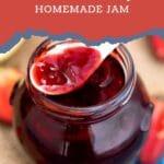 Spoon hovering over jam jar