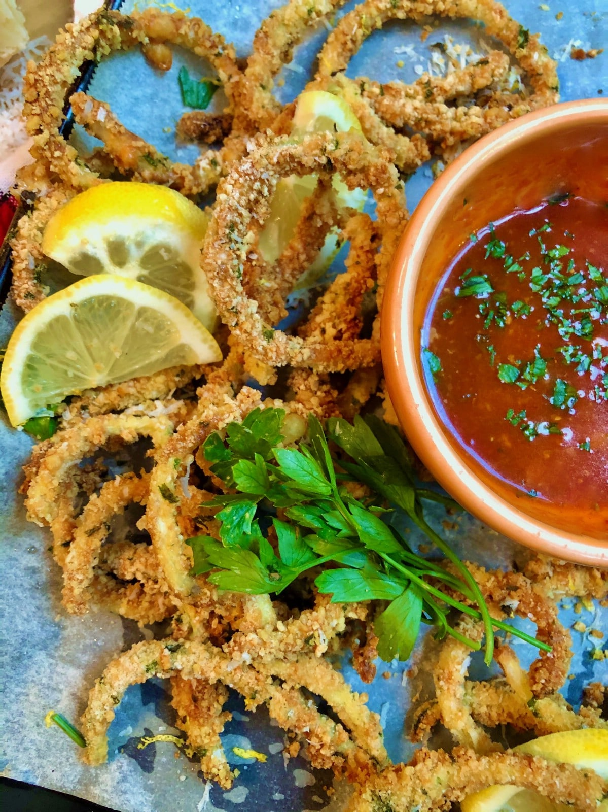 Zucchini fries by bowl of dipping sauce