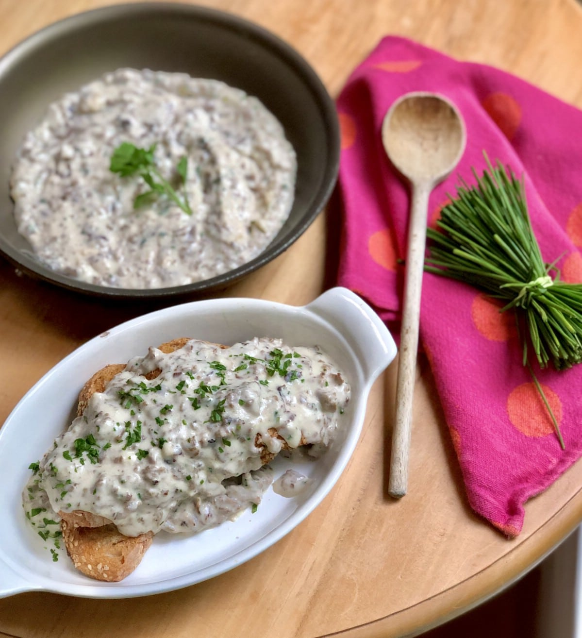 Skillet with chipped beef by serving dish