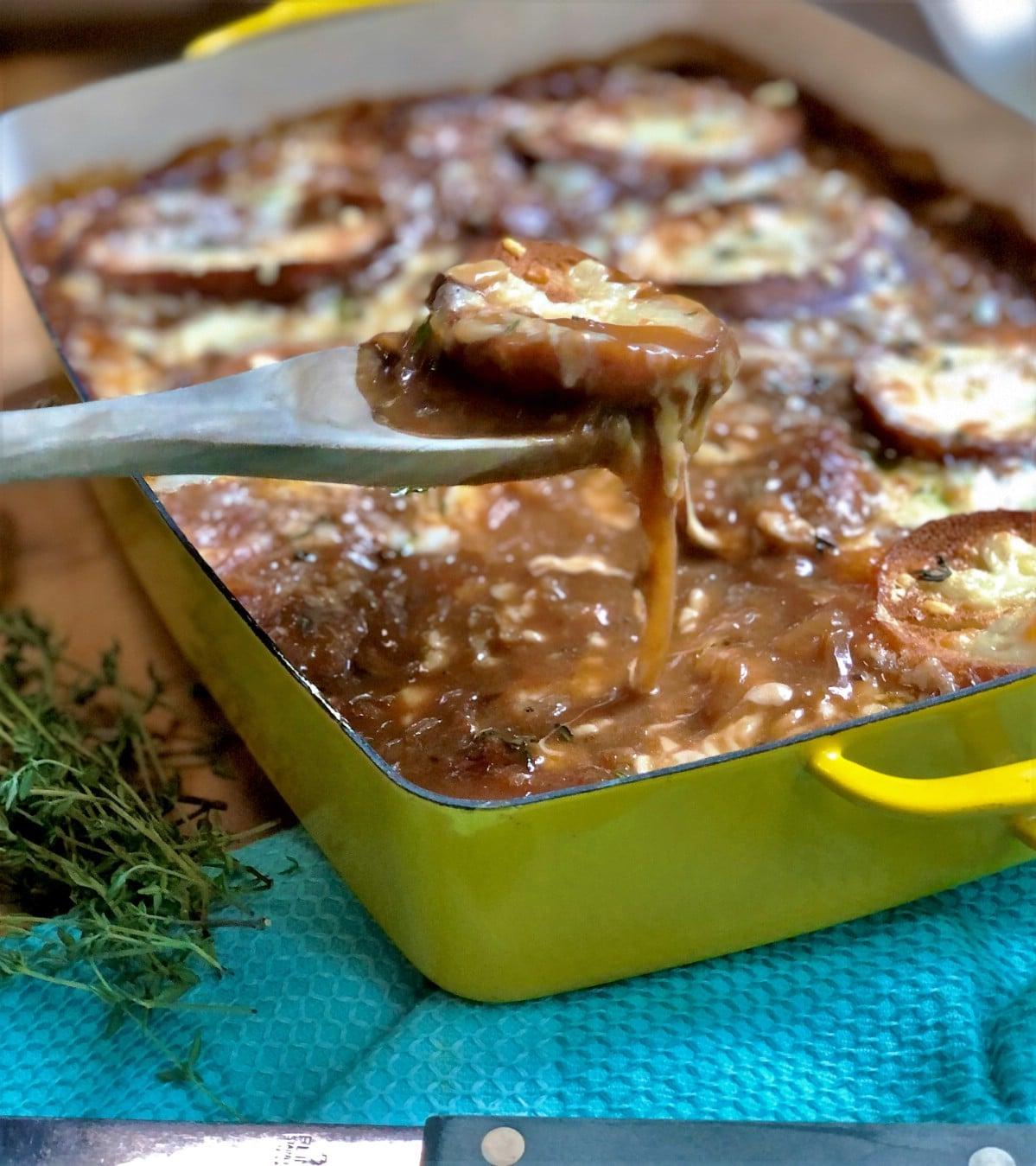 Wooden spoon dishing casserole