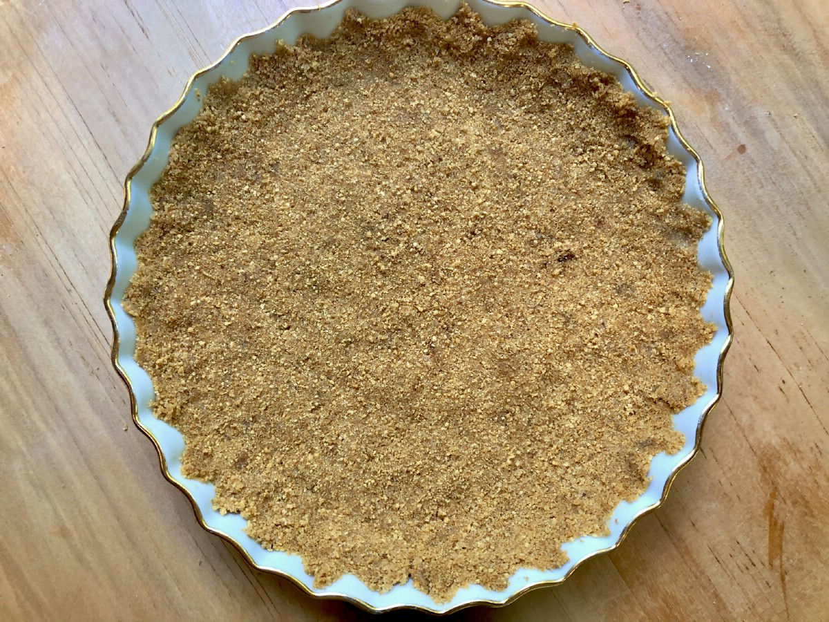 Crust crumbs in tart pan