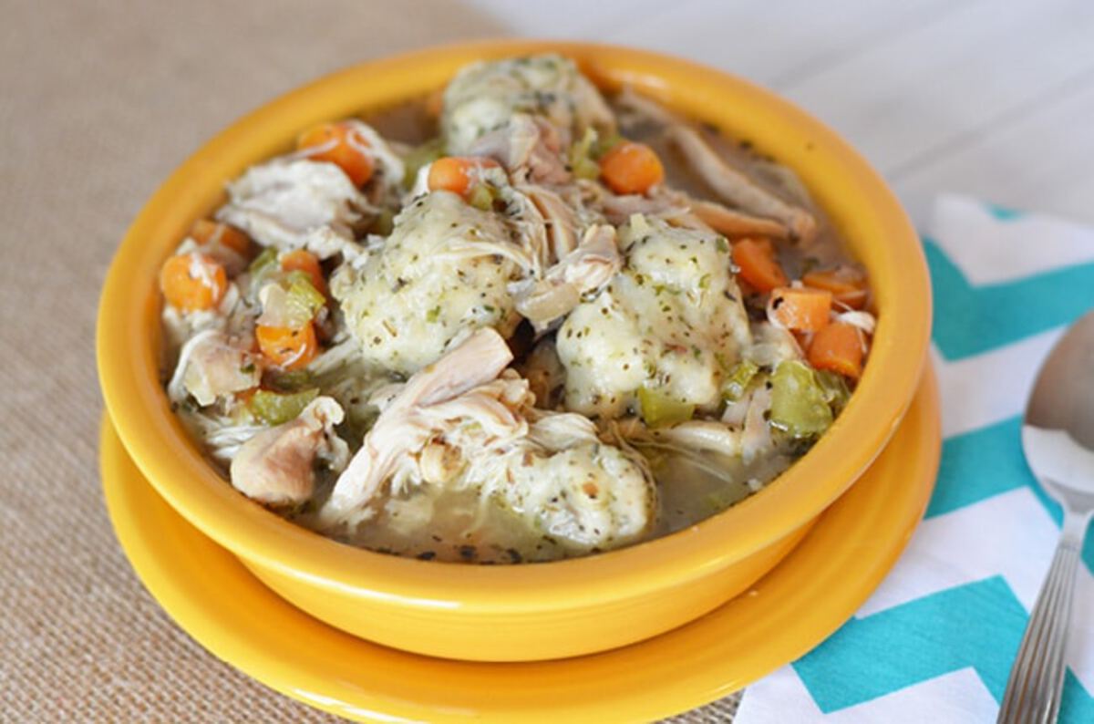 Yellow bowl of chicken and dumplings