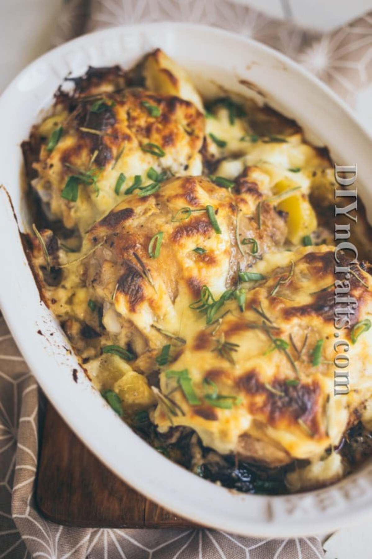 Chicken and potatoes in baking dish