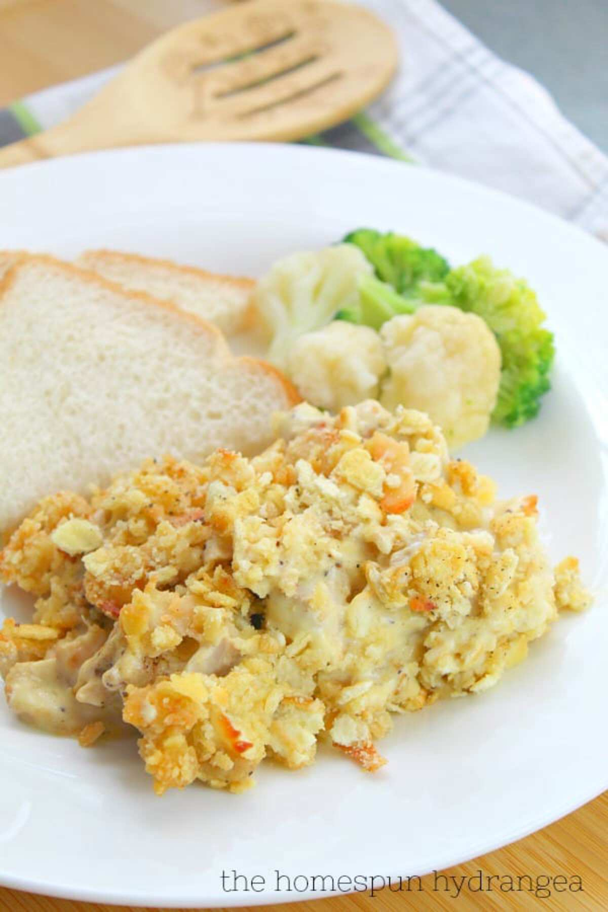 Chicken casserole on plate with bread