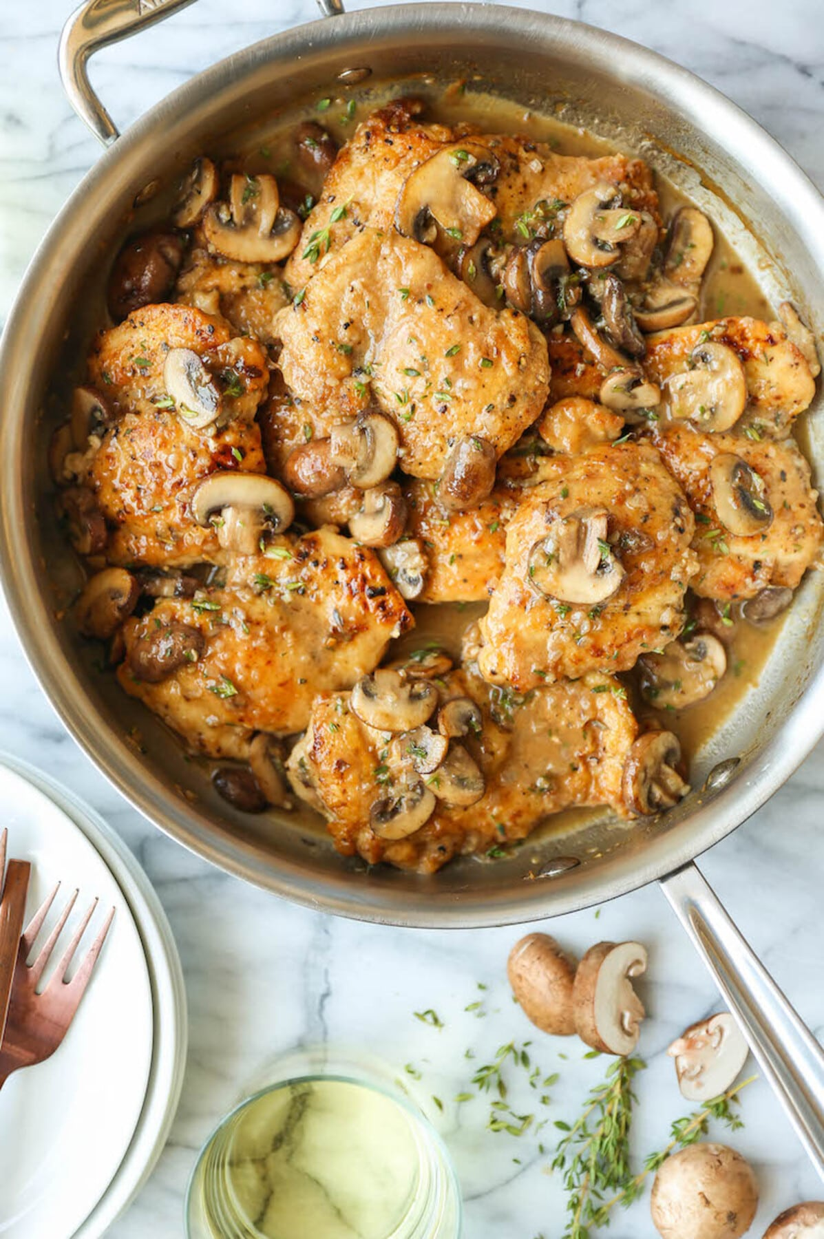 Chicken with mushrooms in skillet