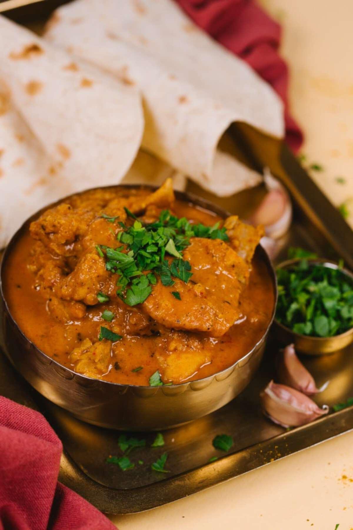 Chicken in brass curry bowl