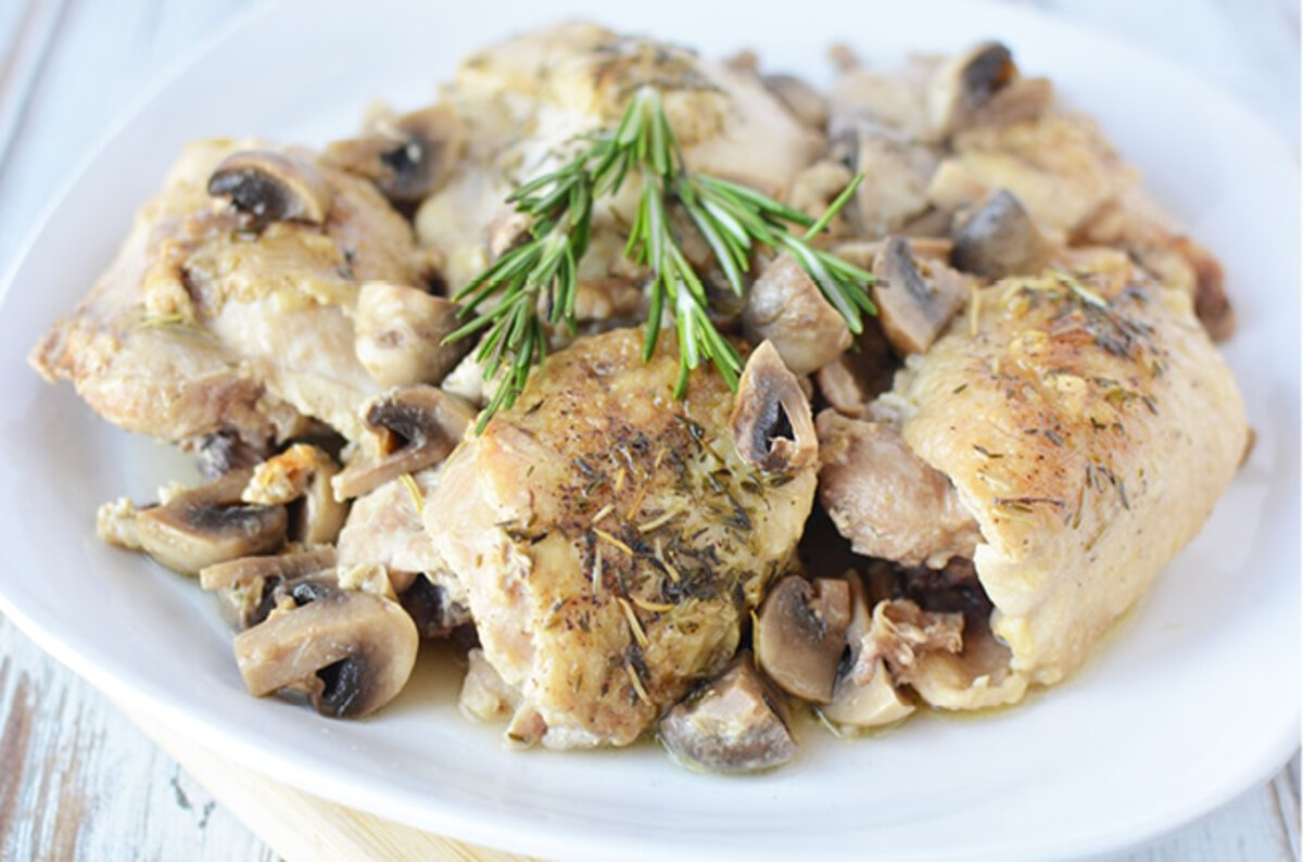 Chicken with mushrooms on white plat