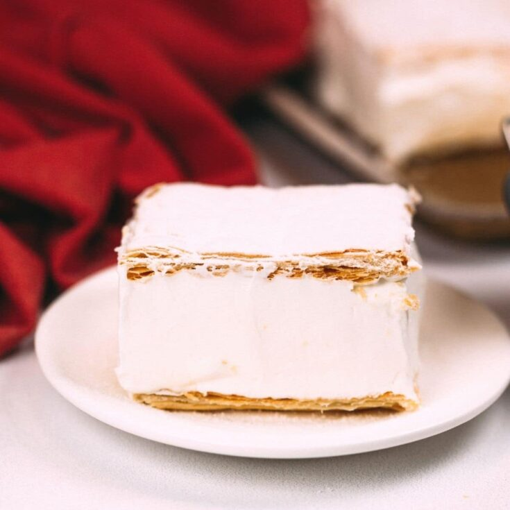 Puff pastry cake on white plate