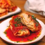 Stuffed cabbage rolls on white plate