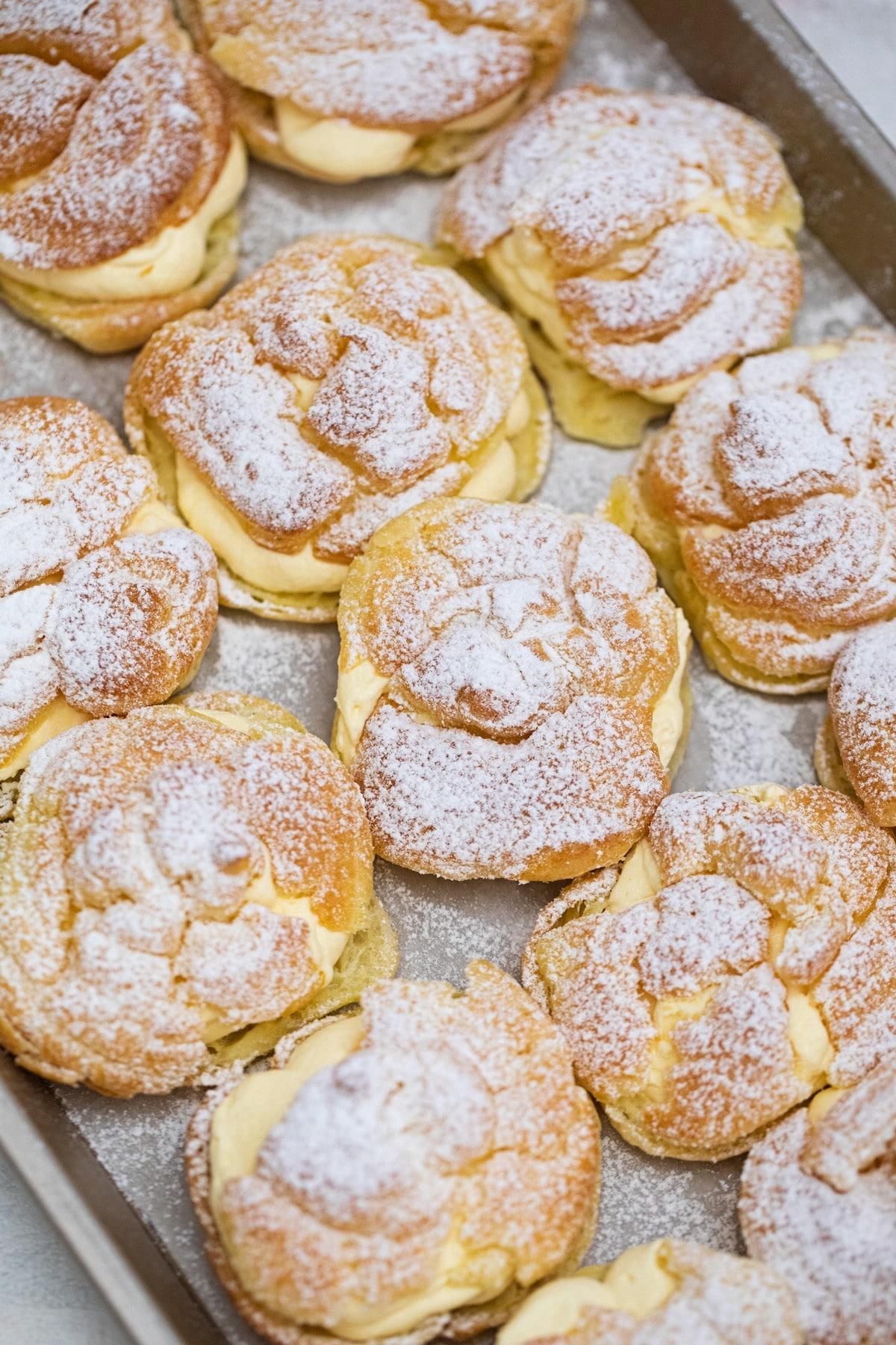Cream puffs on baking sheet