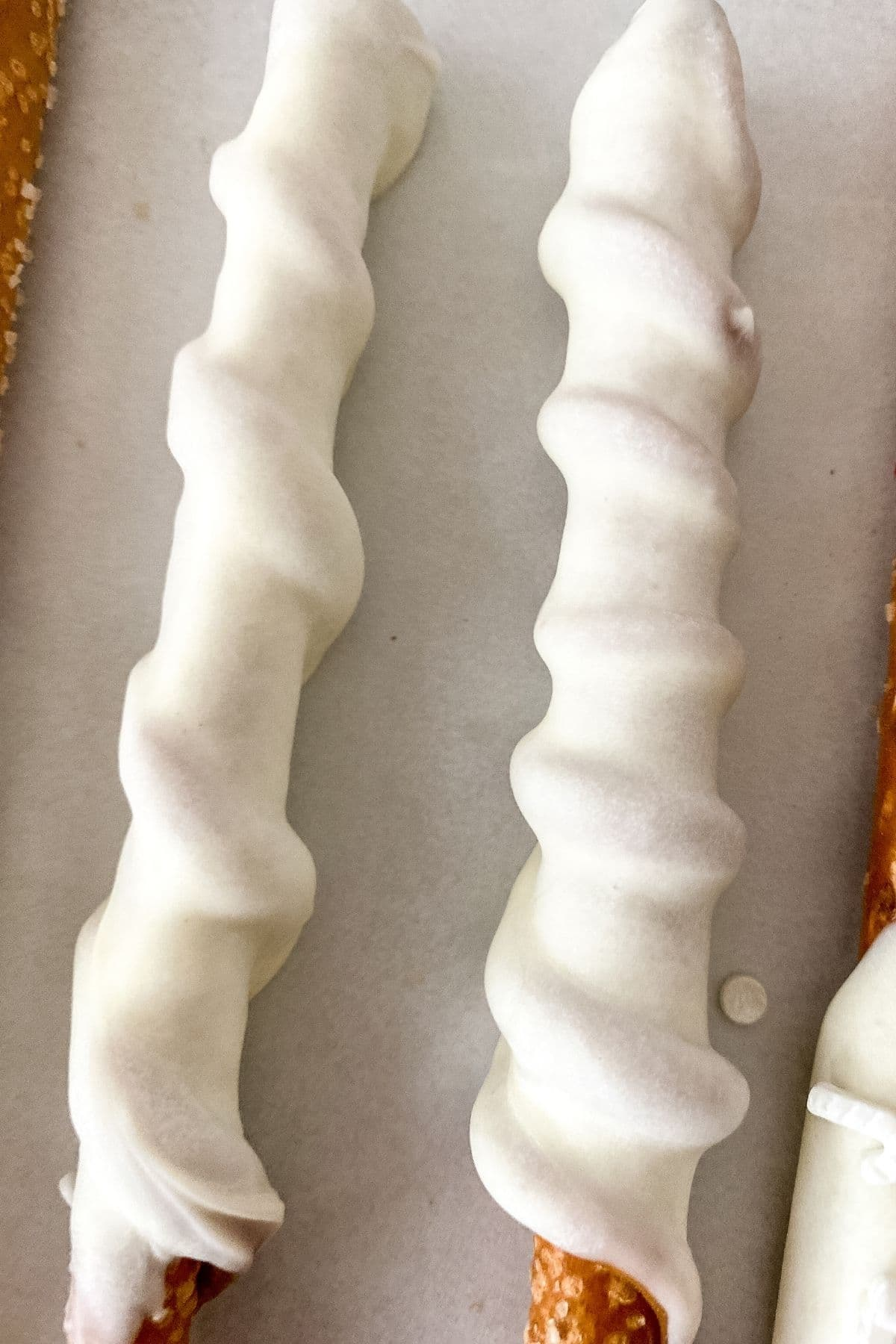 Dipped pretzels on white surface