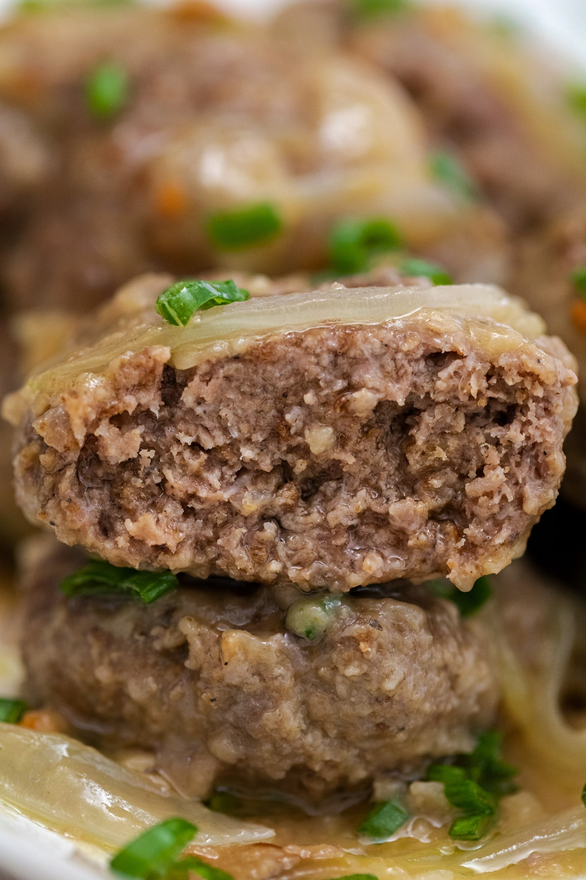 Hamburger patties stacked with onions and parsley