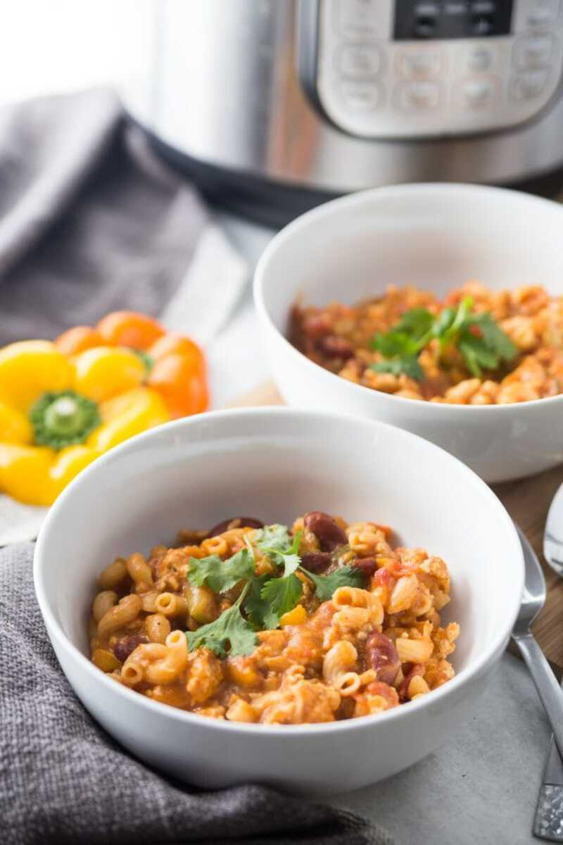 Chili mac in white bowls