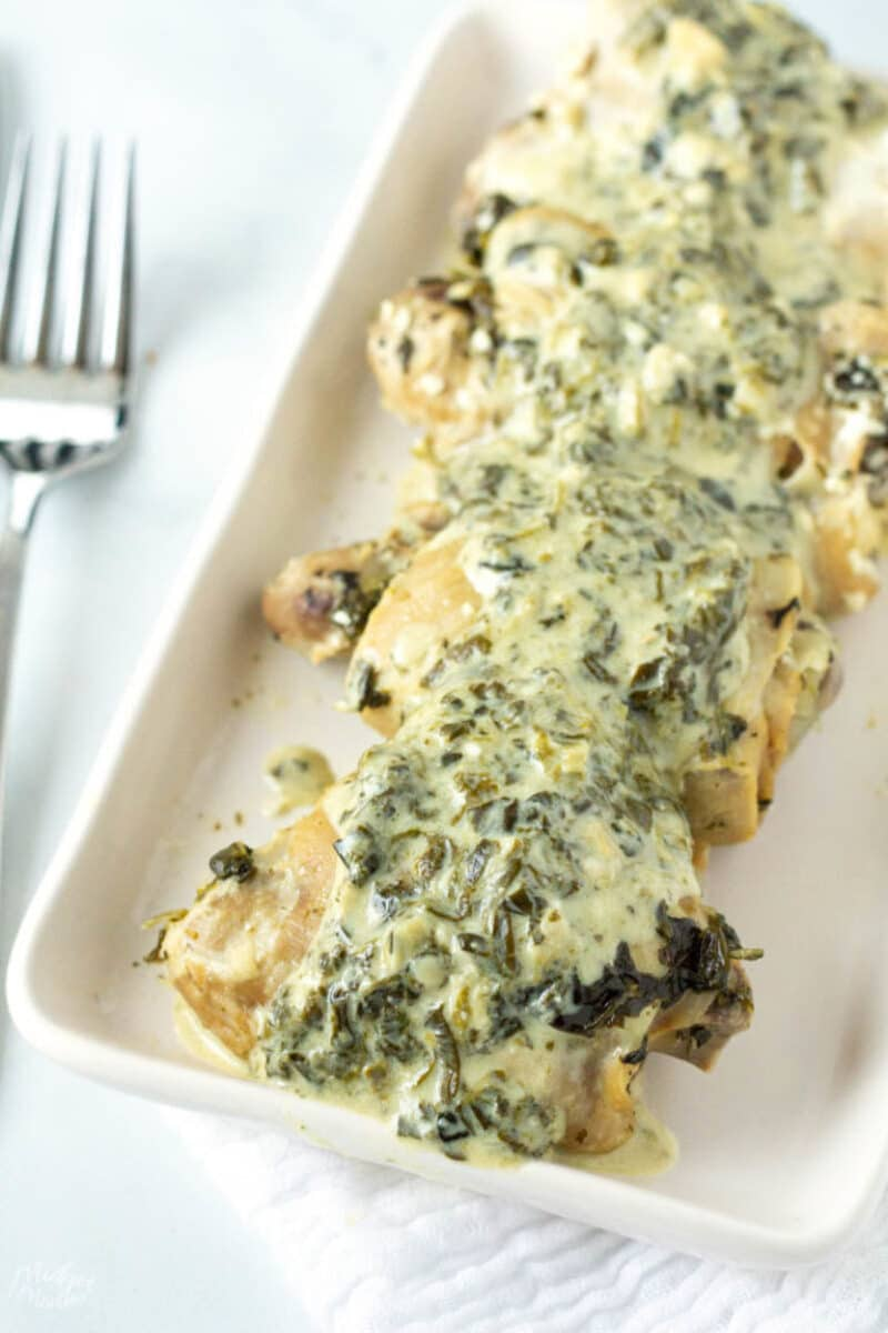 Artichoke spinach chicken on platter